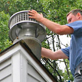 Chimney Sweep replacing damaged Chimney Cap off Farmington's Meadow Rd