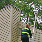 Certifed Chimney Sweep doing a Chimney Inspection on home in Bloomfield CT near Bloomfield HS