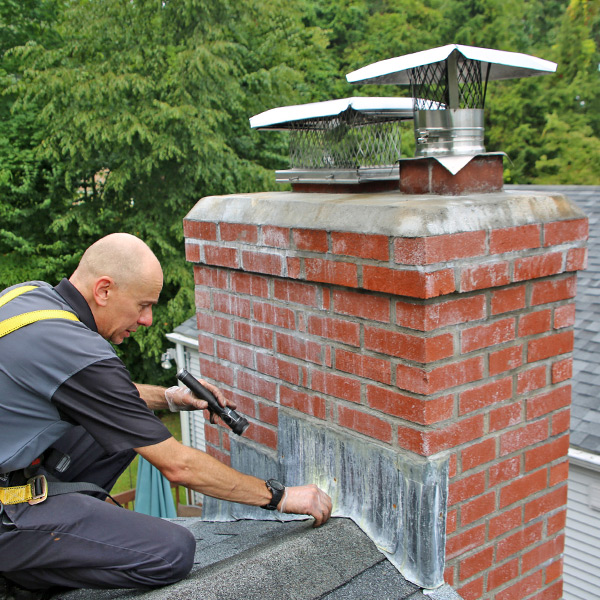 Chimney Technician doing a Chimney Inspection for home on Hartland Rd Granby CT